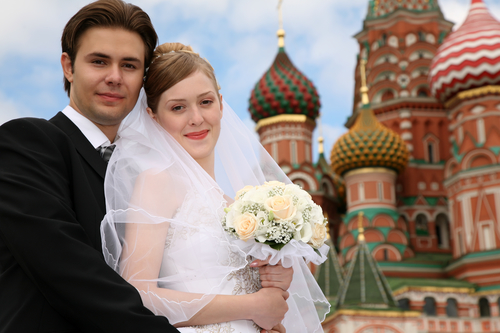 bride, fiance and St.Basil cathedral